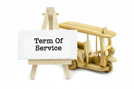 word term of service on white canvas frame and wooden easel, isolated white background. iconic thailand public transport,called tuktuk Stock Photo