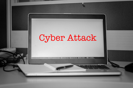 cyber defence: cyber security concept. red word cyber attack display on laptop screen.Black and white image and selective focus