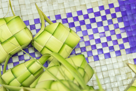 Ketupat or Dumpling Rice. A rice is cook in natural casing made from young coconut leaves. most iconic food during Eid Mubarak Celebration in Malaysia. Selective focus shot