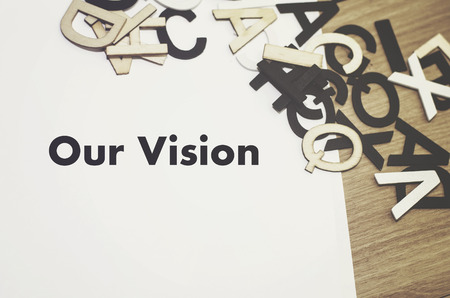 our: conceptual image, word OUR VISION on wooden background. alphabet word on the right Stock Photo