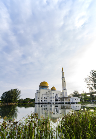 Tranquil lake surrounded As-Salam Mosque located in Selangor, Malaysia with reflection on the lake.