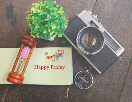 word HAPPY FRIDAY on note pad with decorative item background for enjoyment and celebration concept Stock Photo