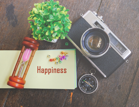 respond: word HAPPINESS on note pad with decorative item background for enjoyment and celebration concept Stock Photo