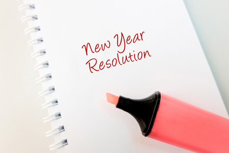 business support concept, word new year resolution on white book and highlighter pen