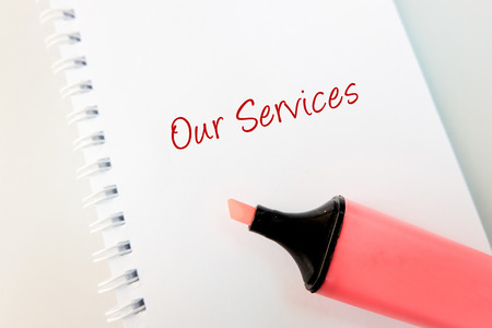 business support concept, word OUR SERVICES g on white book and highlighter pen