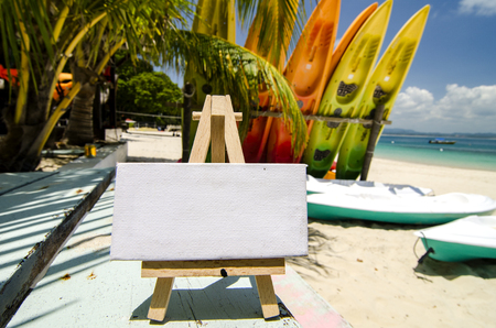 word Travel Blog for travel and holiday concept. beautiful beach and kayaks stacking at sunny day. selective focus shot