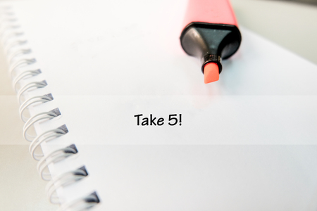 procrastination: word TAKE 5 on white book with highlighter pen ideal for business success concept Stock Photo
