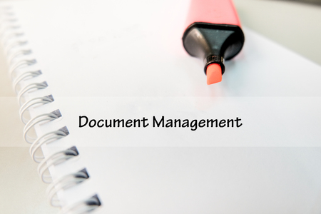 word DOCUMENT MANAGEMENT on white book with highlighter pen ideal for business success concept