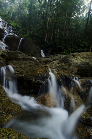 beautiful in nature Kanching Waterfall located in Malaysia, amazing cascading tropical waterfall. wet and mossy rock, surrounded by green rain forest