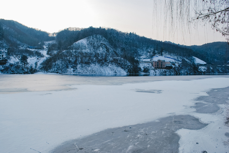 Beautiful nature,park covered by snow and freezing lake during winter Stock Photo