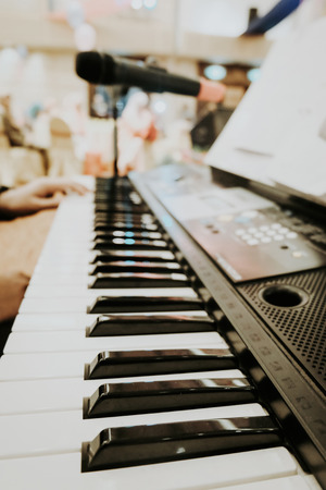 selective focus and closeup view of music instrument, man hand play synthesiser electronic keyboard Stock Photo