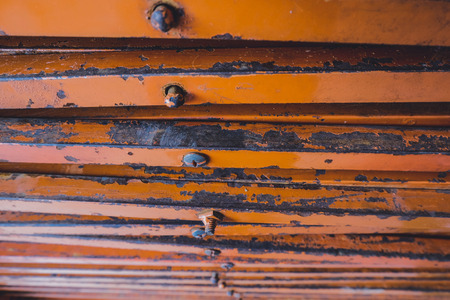 ferrous: closed up stacks of rusty stainless table stands background.faded effect and selective focus