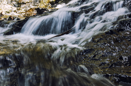 beautiful nature,cascaded tropical river flowing through over wet rock at sunny day Stock Photo