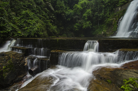 surrounded: Beautiful in nature landscape, waterfall stream surrounded by green tropical green forest