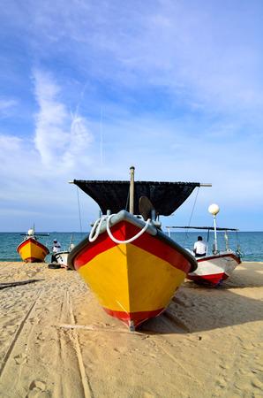 trawler net: Traditional Malaysian fisherman boat on sandy beach