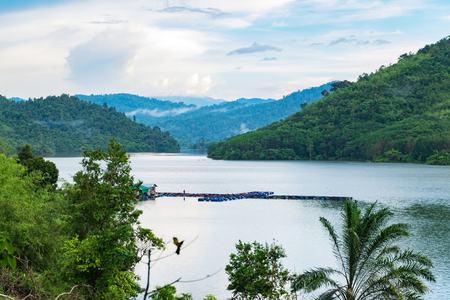 surrounded: beautiful nature, lake surrounded by hill over cloudy sky background