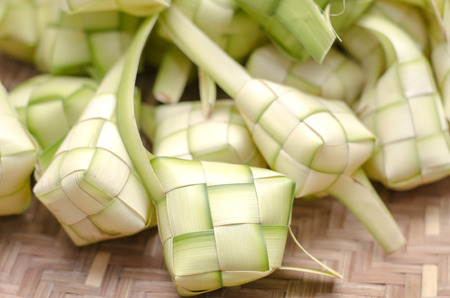 ketupat casing in bamboo container. traditional malay delicacy during Malaysian eid festival Stock Photo