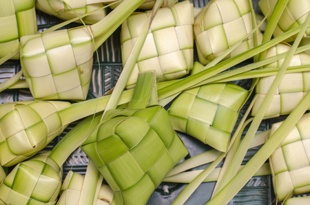 ketupat casing and rice in bamboo container. traditional malay delicacy during Malaysian eid festival Stock Photo