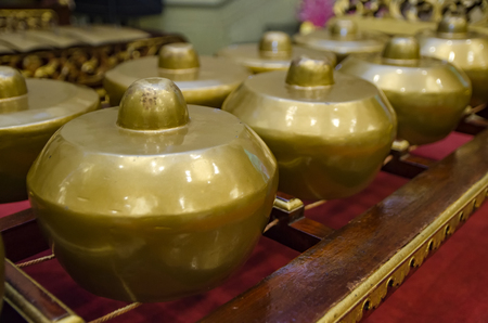symphonic: Malaysian traditional music instrument called Gamelan with beautiful wood carving frame. selective focus shot