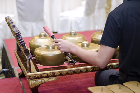 playing Malaysian traditional music instrument called Gamelan. selective focus shot