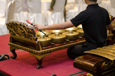 Group of gamelan orchestra playing harmonic song, Gamelan is Malaysian traditional music instrument haritage.selective focus shot