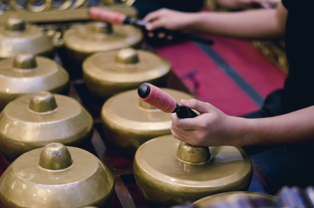 Malaysian traditional music instrument called Gamelan with beautiful wood carving frame. selective focus shot