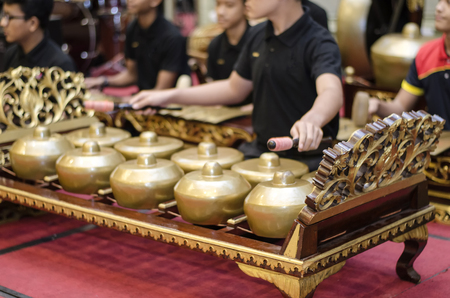 cropped image group of gamelan orchestra playing harmonic song, Gamelan is Malaysian traditional music instrument haritage.selective focus shot Stock Photo