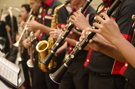 KUALA LUMPUR, MALAYSIA 12 JULY 2017: Group of Malaysian high school boys performing flute, trumpet and saxophones orchestra on the hotel stage Editorial