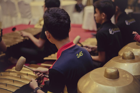 KUALA LUMPUR, MALAYSIA 12 JULY 2017: Group of Malaysian performing Gamelan Orchestra on hotel stage.Gamelan is traditional malay music instrument