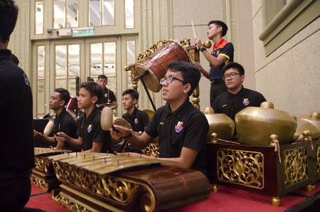 KUALA LUMPUR, MALAYSIA 12 JULY 2017: Group of Malaysian performing Gamelan Orchestra and traditional music instrument on hotel stage