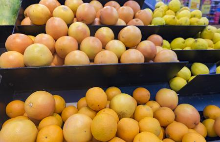 supermarket: Fresh raw orange stacking for sale in supermarket
