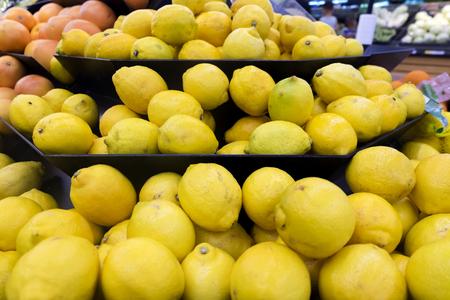 supermarket: Fresh raw lemons display for sale in supermarket Stock Photo