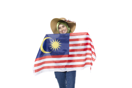 young malaysian civilian with happy face celebrating independent day. hand holding flag.isolated white background Stok Fotoğraf