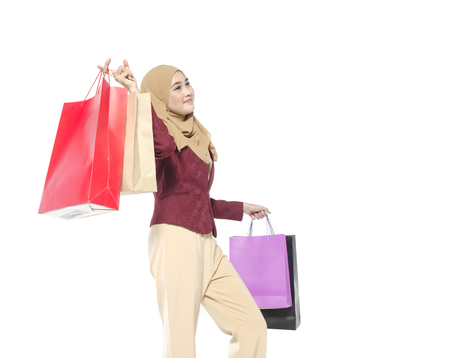 happy muslimah carry shopping bag isolated on white background ideal for hobby and lifestyle concept