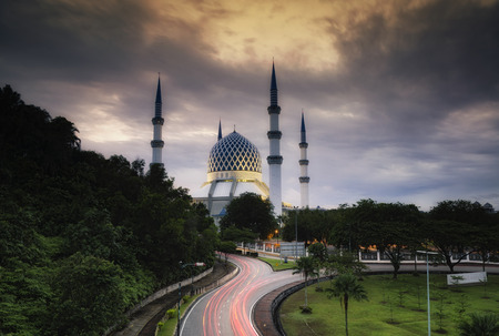 The beautiful Sultan Salahuddin Abdul Aziz Shah Mosque over stunning sunrise background. soft focus due to long exposure shot.
