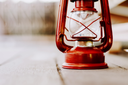 Vintage lantern on wooden floor, copy space to the left for text Stock Photo