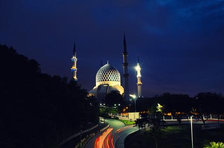The beautiful Sultan Salahuddin Abdul Aziz Shah Mosque over stunning sunrise background. soft focus and low light shot