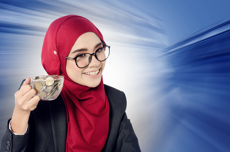 Creative ideas concept, successful young muslimah businesswomen over abstract double exposure Stock Photo
