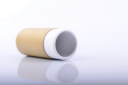 Recycled cylinder paper tube container on white background