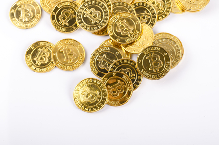 Conceptual image for worldwide cryptocurrency, huge stack physical version of golden Bitcoin on white background