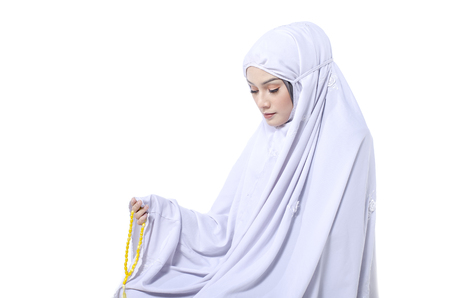 concept for eid mubarak and soul fasting of islamic ramadan, young female muslim with hijab holding rosary beads