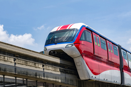 Red Monorail operation over blue sky background