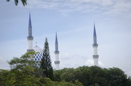 The beautiful Sultan Salahuddin Abdul Aziz Shah Mosque under bright sunny day and moody sky background