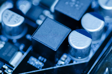 selective focus effect and macro view of the group of electronic components on mainboard circuit board