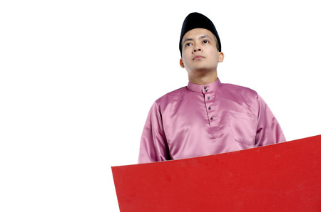 Portrait of young and handsome asian man with traditional clothing holding red cardboard