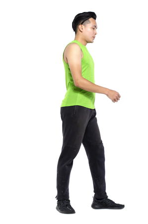 Full body length portrait of young fit man in sportswear, standing over white background Stock fotó