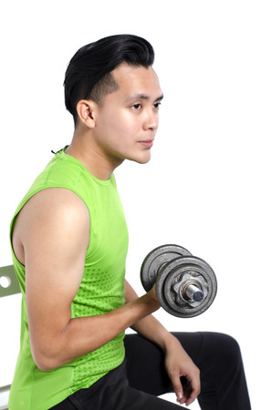 healthy lifestyle concept, young fit man in sportswear , holding dumbbell over white background