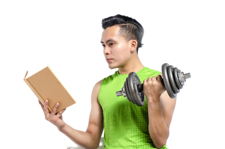 healthy lifestyle concept, cropped face young fit man in sportswear, holding dumbbell and book over white background Stock fotó