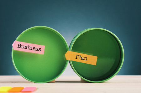 Business concept, word BUSINESS PLAN on sticky paper over beautiful reverberation gradient background Stock Photo