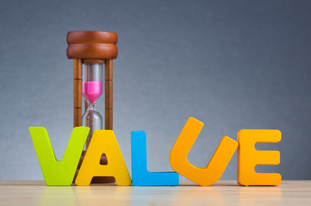 VALUE word made with wooden letter on desk over gently lit dark background for Core fundamental values concept